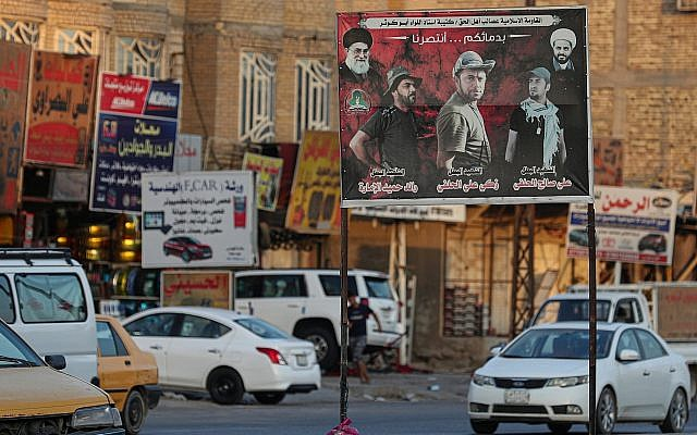 In this photo form September 18, 2019, a billboard depicting Shiite spiritual leaders and volunteer fighters from the Iran-backed Popular Mobilization Forces who were killed in Iraq fighting Islamic State militants, is displayed in Basra, Iraq. (AP Photo/Nabil al-Jurani)