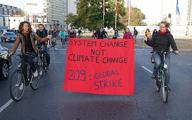 Protesters hold a banner during a bicycle parade in Berlin, Germany, Sept. 20, 2019 as part of the 'Friday For Future' global strike (Kay Nietfeld/dpa via AP)