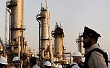 During a trip organized by Saudi information ministry, a security guard stands alert in front of Aramco's oil processing facility after the recent September 14 attack on Aramco's oil processing facility in Abqaiq, near Dammam in the Kingdom's Eastern Province, September 20, 2019. (AP Photo/Amr Nabil)