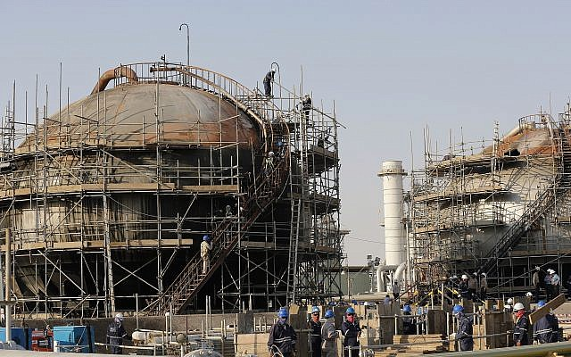 During a trip organized by the Saudi information ministry, workers fix the damage in Aramco's oil separator at processing facility after the September 14 attack in Abqaiq, near Dammam in the Kingdom's Eastern Province, September 20, 2019. (AP Photo/Amr Nabil)