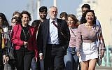 Labour Party leader Jeremy Corbyn, walking along the promenade, arrives for the Labour Party Conference at the Brighton Centre in Brighton, England, September 21, 2019. (Gareth Fuller/PA via AP)