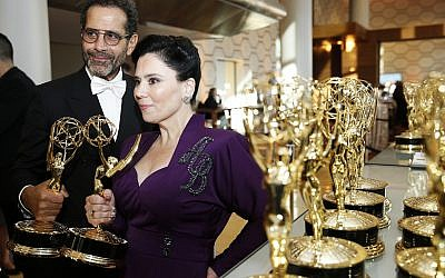 "Tony Shaloub and Alex Borstein accept the award for outstanding supporting actor and actress in a comedy series for ""The Marvelous Mrs. Maisel"" at the 71st Primetime Emmy Awards on Sunday, Sept. 22, 2019, at the Microsoft Theater in Los Angeles. (Photo by Eric Jamison/Invision for the Television Academy/AP Images)"