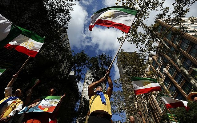 Supporters of regime change in Iran rally outside United Nations headquarters on the first day of the general debate at the UN General Assembly, Sept. 24, 2019, in New York. (AP Photo/Jason DeCrow)