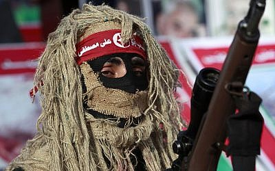 Illustrative: A gunman from the Popular Front for the Liberation of Palestine (PFLP) terror group participates in a rally at the Jabaliya Refugee Camp, in the northern Gaza Strip, March 7, 2014. (AP Photo/Adel Hana)