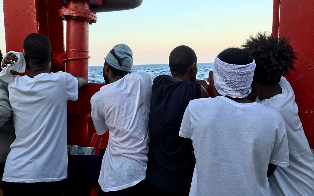 Refugees aboard the Ocean Viking look out over the Mediterranean Sea. (Avra Fialas/SOS Mediterranee)