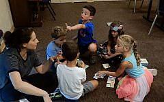 Children in the pre-K class play the Israeli card game 'Melech HaFelafel' on September 4, 2019. (Melanie Lidman/Times of Israel)