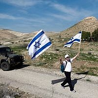 Illustrative: Israelis take part in an annual 8-kilometer march in the Jordan Valley. February 21, 2014. (Yonatan Sindel/FLASH90)