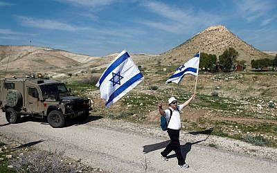 Illustrative: Israelis take part in an annual 8-km march in the Jordan Valley. February 21, 2014. (Yonatan Sindel/FLASH90)