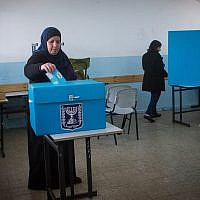 Israelis cast their votes at a polling station in the Arab town of Beit Safafa on March 17, 2015. (Miriam Alster/Flash90)
