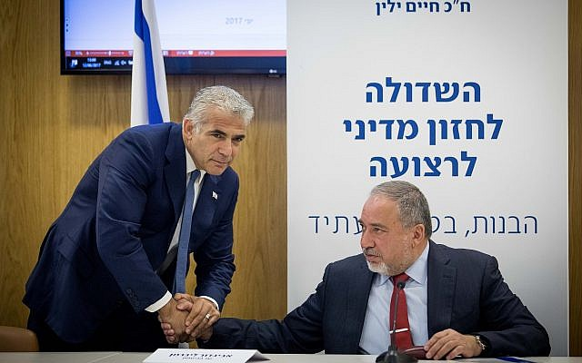 Then Yesh Atid party leader MK Yair Lapid and at the time Defense Minister Avigdor Liberman in the Knesset, June 12, 2017. (Yonatan Sindel/Flash90)