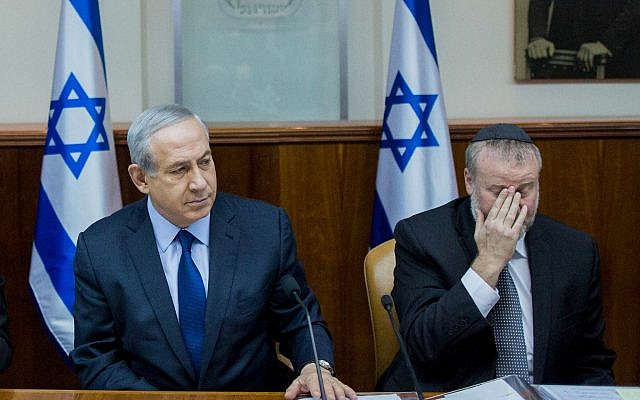 Prime Minister Binyamin Netanyahu (L) and then-cabinet secretary Avichai Mandelblit at the weekly government conference, at the Prime Minister's Office in Jerusalem, on December 13, 2015. (Yonatan Sindel/Flash90)