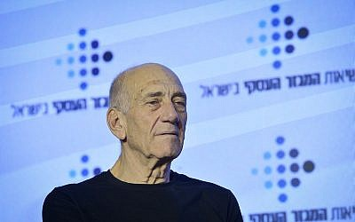 Former prime minister Ehud Olmert speaks at a conference of business organizations, in Tel Aviv on February 21, 2019 (Ben Dori/Flash90)