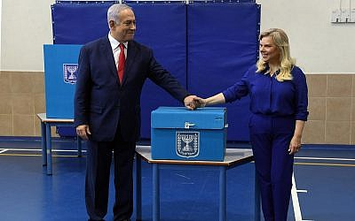 Prime Minister Benjamin Netanyahu and his wife Sara cast their vote at a polling station in Jerusalem during the Knesset elections, April 9, 2019. (Haim Zach/GPO)