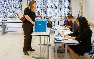 An Israeli votes in Haifa, during the Knesset elections on April 9, 2019. (Meir Vaknin/ Flash90)