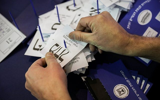 Illustrative: Israelis count the remaining ballots from soldiers and absentees at the parliament in Jerusalem, a day after the general elections, April 10, 2019. (Noam Revkin Fenton/Flash90)