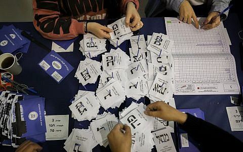 The remaining ballots from soldiers and absentees being counted at the Knesset on April 10, 2019, a day after the general elections, (Noam Revkin Fenton/Flash90)