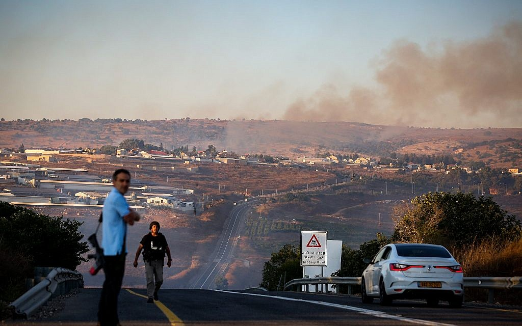 Smoke rises from a fire caused from a rocket fired from Lebanon near Moshav Avivim on the border with Lebanon, in northern Israel, September 1, 2019. (David Cohen/Flash90)