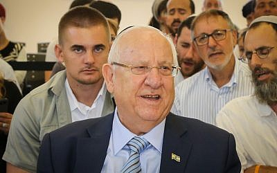 President Reuven Rivlin attends a ceremony in memory of Dvir Sorek, an 18-year-old Israeli killed in a terror attack, during the opening of the school year at the yeshiva where Sorek studied in the West Bank settlement of Migdal Oz, September 1, 2019. (Gershon Elinson/Flash90)