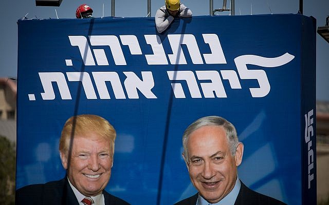 Israeli workers hang a large billboard with pictures of US president Donald Trump and Israeli prime minister Benjamin Netanyahu, as part of the Likud election campaign, in Jerusalem on September 4, 2019. (Yonatan Sindel/Flash90)
