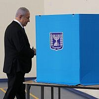 Prime Minister Benjamin Netanyahu votes at a polling station in Jerusalem on September 17, 2019. (Alex Kolomoisky/Pool/Flash90)