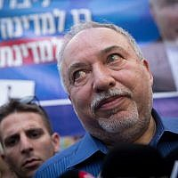Yisrael Beytenu leader Avigdor Liberman speaks to press while touring the Sarona Market in Tel Aviv on election day, September 17, 2019. (Miriam Alster/Flash90)