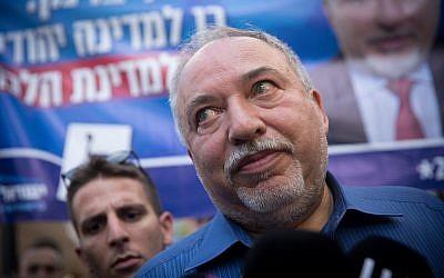 Yisrael Beytenu leader Avigdor Liberman speaks to press while touring the Sarona Market in Tel Aviv on election day, September 17, 2019. (Miriam Alster/Flash90)