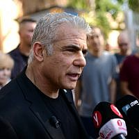 Blue and White party MK Yair Lapid speaks to the media after casting his ballot at a voting station in Tel Aviv on September 17, 2019. (Tomer Neuberg/Flash90)