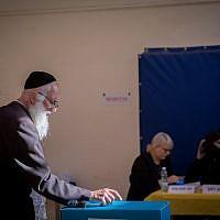 Illustrative: A man casts his vote at a voting station in Jerusalem during the Knesset elections, on September 17, 2019. (Yonatan Sindel/Flash90)