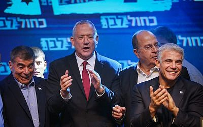 Blue and White party chairman Benny Gantz  (second left) with colleagues (from right) Yair Lapid, Moshe Ya'alon and Gabi Ashkenazi at party headquarters on elections night in Tel Aviv, early September 18, 2019. (Hadas Parush/Flash90)