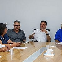 Head of the Joint List party Ayman Odeh (second from right) seen with party members during a faction meeting in Kfar Qasim, on September 21, 2019. (Roy Alima/Flash90)