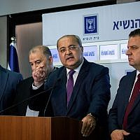 MK Ahamd Tibi, center, together with members of the Joint List hold a press conference after meeting with President Reuven Rivlin at the President's Residence in Jerusalem on September 22, 2019. (Yonatan Sindel/Flash90)