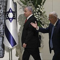President Reuven Rivlin, right, and Prime Minister Benjamin Netanyahu arrive for a press conference to give Netanyahu the mandate to form a new government, held at the President's Residence in Jerusalem on September 25, 2019. (Yonatan Sindel/Flash90)
