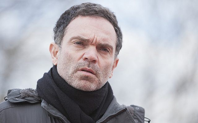 French novelist Yann Moix visiting a meal distribution center for migrants in Calais, France, March 5, 2018. (Jeremias Gonzalez/IP3/Getty Images)