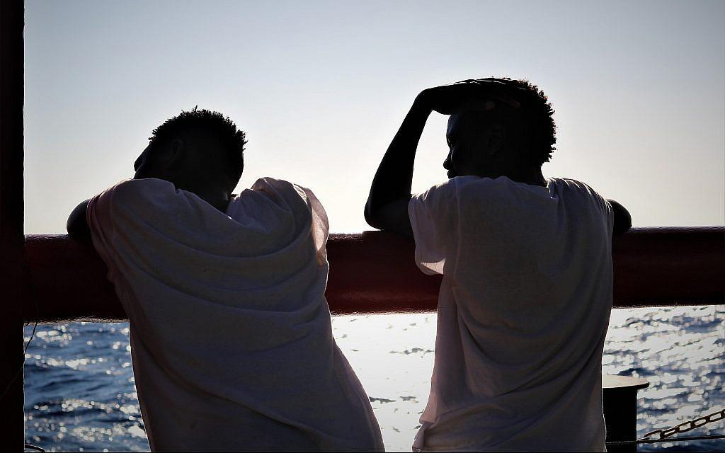 Refugees aboard the Ocean Viking look out over the Mediterranean Sea. (Hannah Wallace Bowman/SOS Mediterranee)