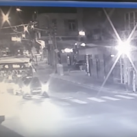 """Security camera footage shows a man running from a group of Hapoel Tel Aviv supporters after apparently yelling """"Let's go Beitar"""" at them, on September 8, 2019. (Screen capture: YouTube)"""