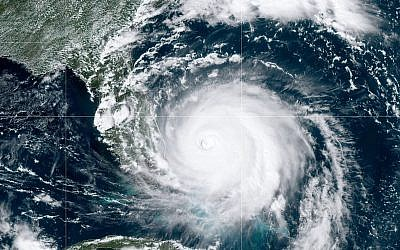 Hurricane Dorian, now a Category 4 storm, moves past grand Bahama Island in the Atlantic Ocean on its way toward the Florida coast on Sept, 2, 2019 in this image from the National Oceanic and Atmospheric Administration (NOAA via Getty Images/ JTA)