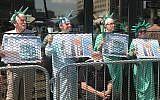 Several members of ElderWitness and Friends protest outside ICE's office in Philadelphia. (Courtesy of Rabbi Arthur Waskow via JTA)