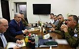 Prime Minister Benjamin Netanyahu (2nd R) meets, following a rocket attack from Gaza, with his defense chiefs at the Kirya military base in Tel Aviv on September 10, 2019 (Ariel Hermoni/Defense Ministry)