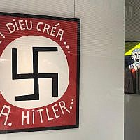 Painting by Fatmir Limani featuring a large swastika at the Bog-Art gallery in Brussels, Belgium. (LBCA via JTA)