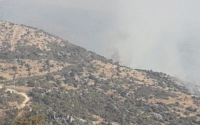 Smoke rises from a fire sparked by Israel near the contested Mount Dov area along the Israel-Lebanon border on September 1, 2019. (Twitter)