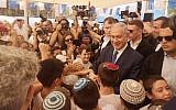 Prime Minister Benjamin Netanyahu meeting schoolkids in the West Bank settlement of Elkana on the first day of school, September 1, 2019. (Courtesy)