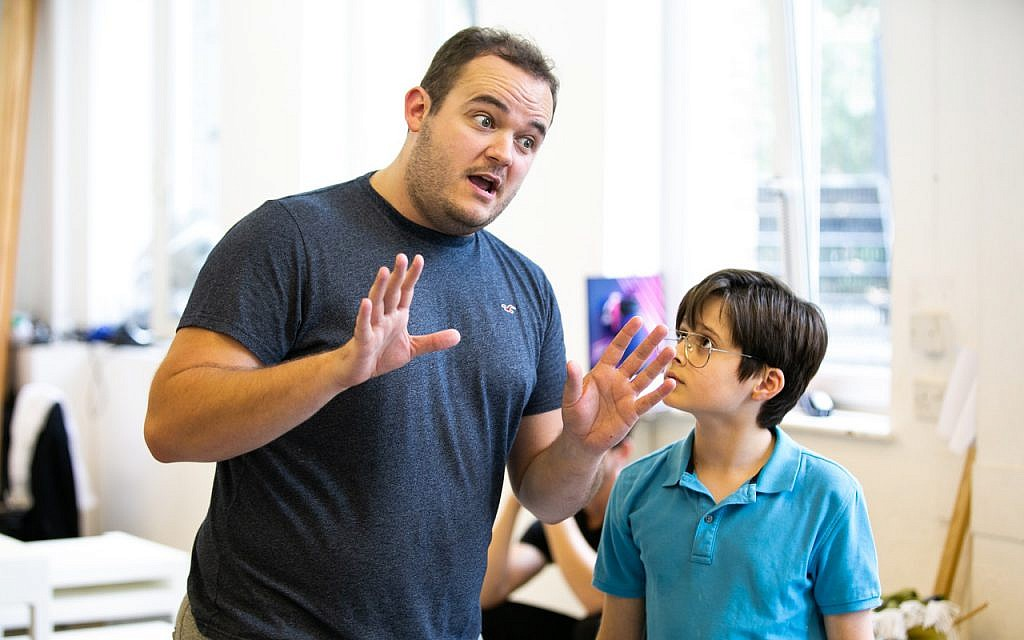 Joel Montague as Mendel, left, and Albert Atack as Jason, right, during a rehearsal for the UK production of 'Falsettos,' which contains no known Jewish actors. (Matthew Walker)