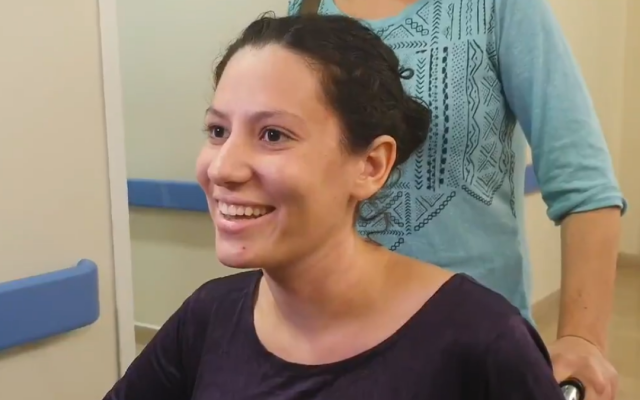 Noam Nevis, injured in a car-ramming attack outside the West Bank settlement of Elazar, speaks to reporters as she is discharged from Hadassah Hospital Ein Kerem on September 1, 2019. (Screen capture: Twitter)