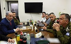 Prime Minister Benjamin Netanyahu (L) is seen with security chiefs at the IDF's Tel Aviv headquarters on September 10, 2019, hours after a rocket attack on Ashdod forced him to run for shelter during a campaign rally (Ariel Hermoni/Defense Ministry)