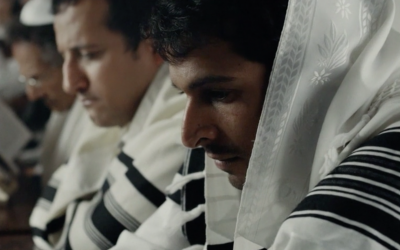 Yehuda Nahari, right, portrays Yigal Amir in the movie 'Incitement.' (Screen capture/Channel 12)