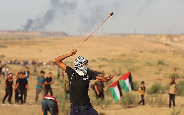 Illustrative: Palestinians clash with Israeli forces at a demonstration near the Shuja'iyya neighborhood of Gaza City, September 20, 2019. (Hassan Jedi/Flash90)