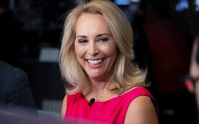 Former CIA operative Valerie Plame is interviewed on the floor of the New York Stock Exchange, October 22, 2018. (AP Photo/Richard Drew, File)