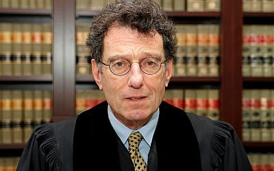 US District Judge Dan Polster poses for a portrait in his office in Cleveland, January 11, 2018. (AP Photo/Tony Dejak, File)