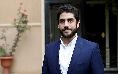 Abdullah Morsi, the youngest son of Egypt's jailed former Islamist President Mohammed Morsi, poses for a photograph in front of his home in Cairo, Egypt, September 30, 2018. (AP Photo/Brian Rohan, File)