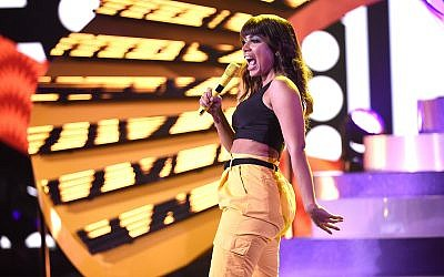 "Brazilian pop star Anitta performs ""Medicina"" at the Latin American Music Awards at the Dolby Theatre, October 25, 2018, in Los Angeles. (Photo by Chris Pizzello/Invision/AP))"